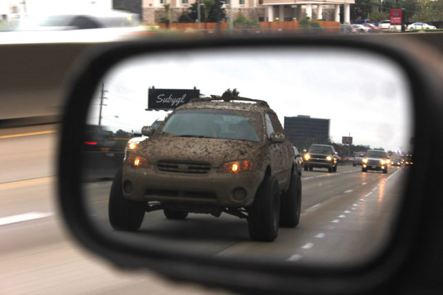 Lifted Subaru in rearview mirror - CRANKSHAFT CULTURE