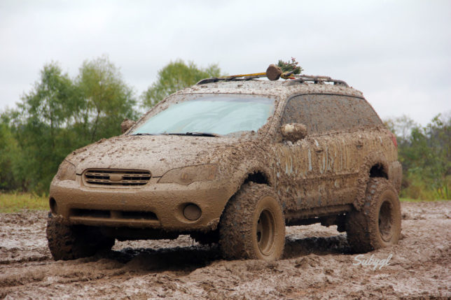Mud covered lifted Subaru Outback - CRANKSHAFT CULTURE