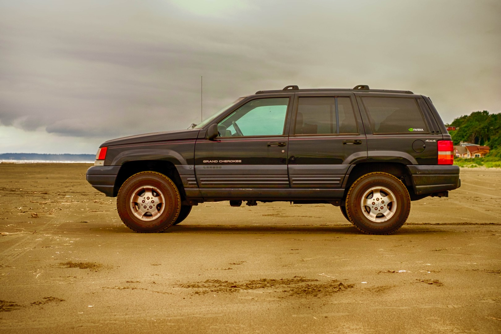 My lifted Jeep Grand Cherokee on the beach.