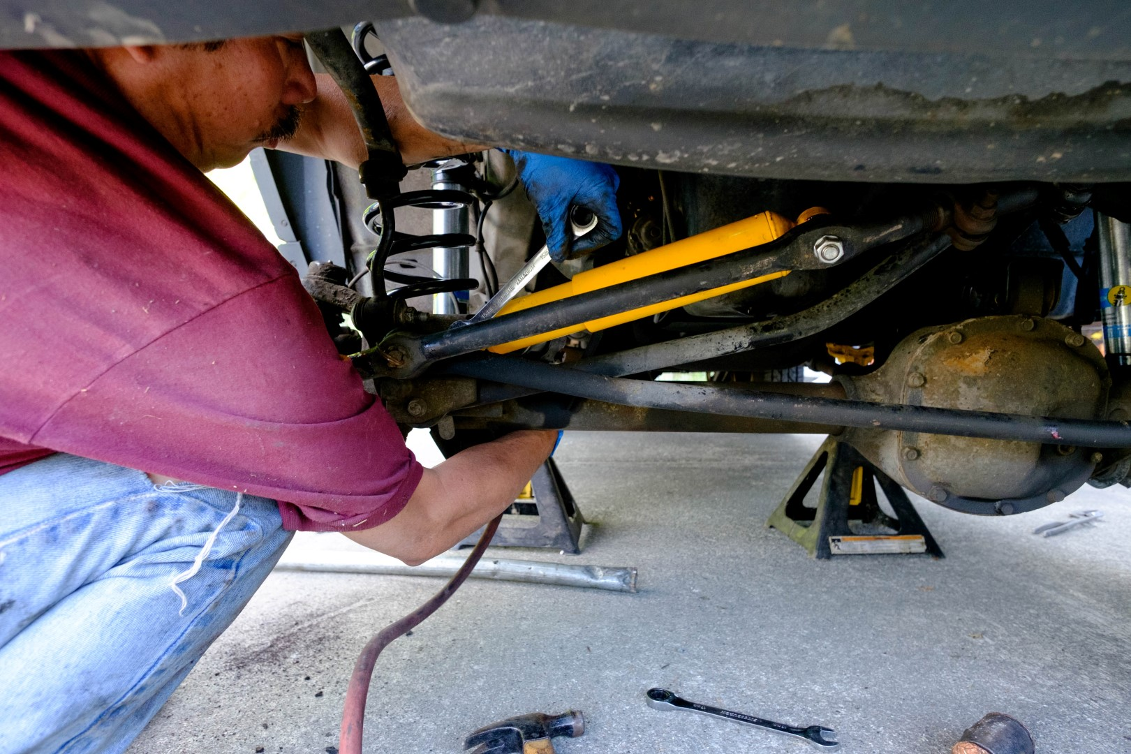 My dad installing the new steering stabilizer
