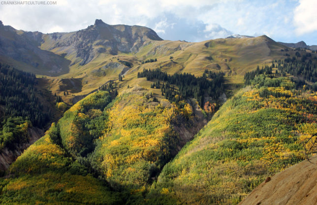 Colorful aspen trees adorn the steep San Juan Mountain hillsides in autumn.