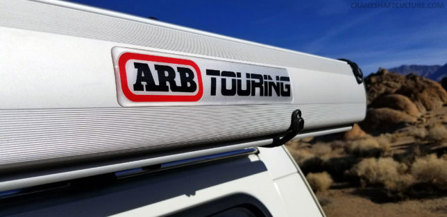 Oversized ARB Touring jellybean sticker on side of awning shell.