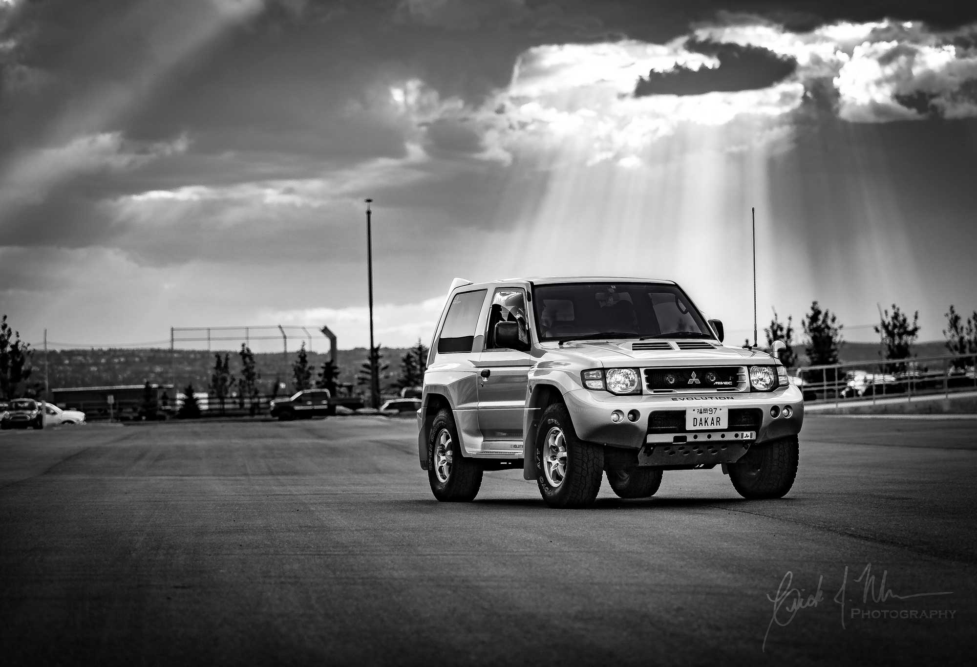 Black and white Mitsubishi Pajero Evo