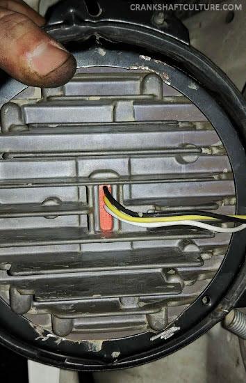 The back of a J.W. Speaker 8700 Evo 2 headlamp.