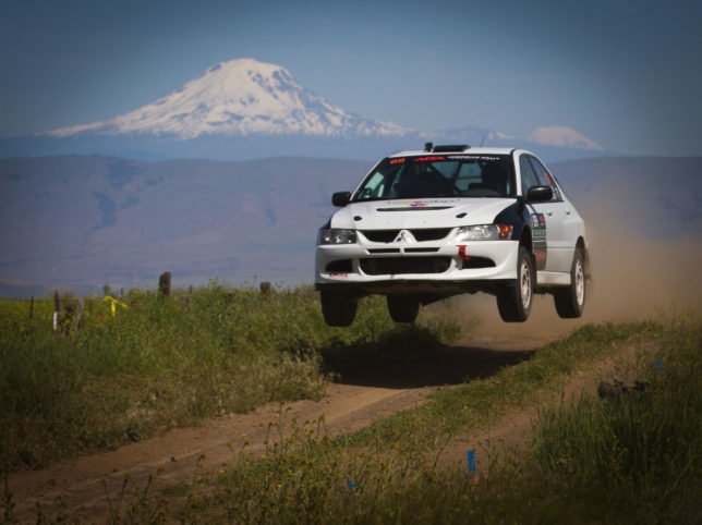 Bryan and Bianca Rodgers launch their 2005 Mitsubishi EVO over Boyd Jump.