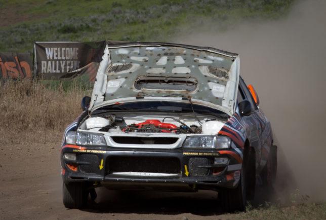 Hood up Impreza rally car