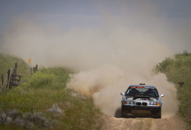 A hoodless BMW blasting down a dusty stage in Dufur.