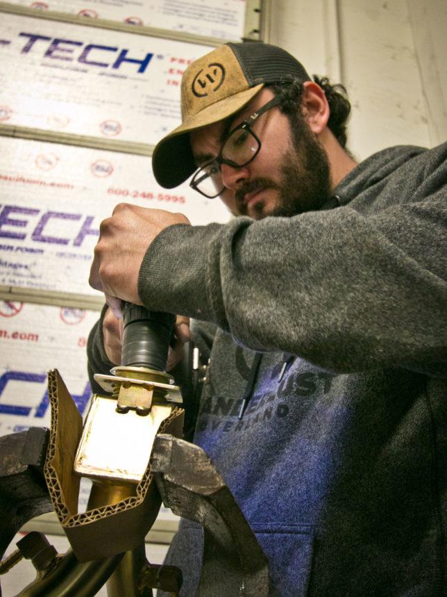 Enlarging hole for fuel filler