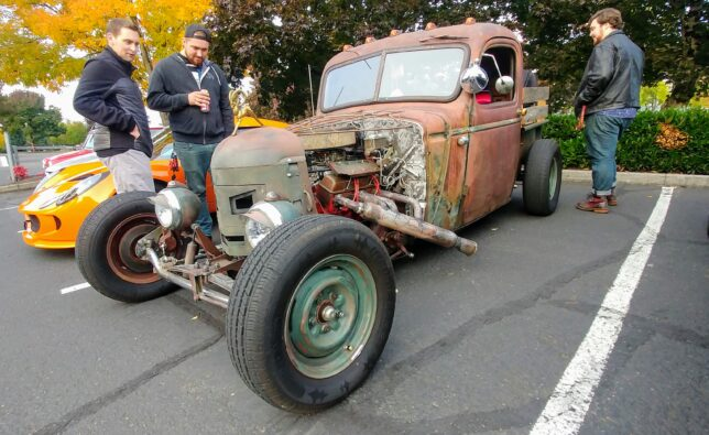 Checking out a vintage rat rod.