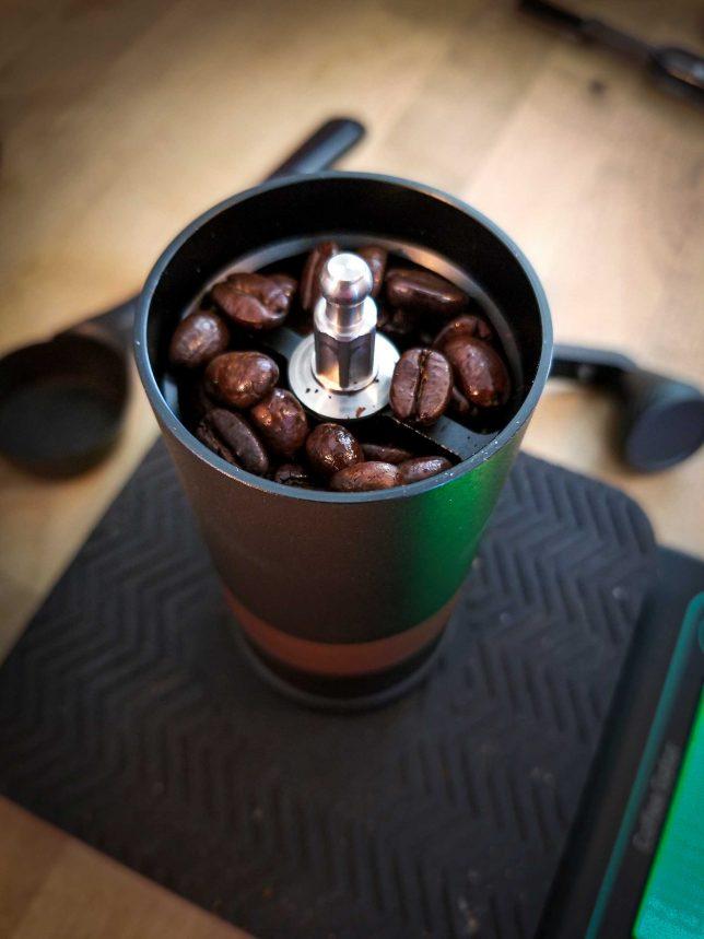 Weighing coffee beans in the VSSL Java coffee grinder.