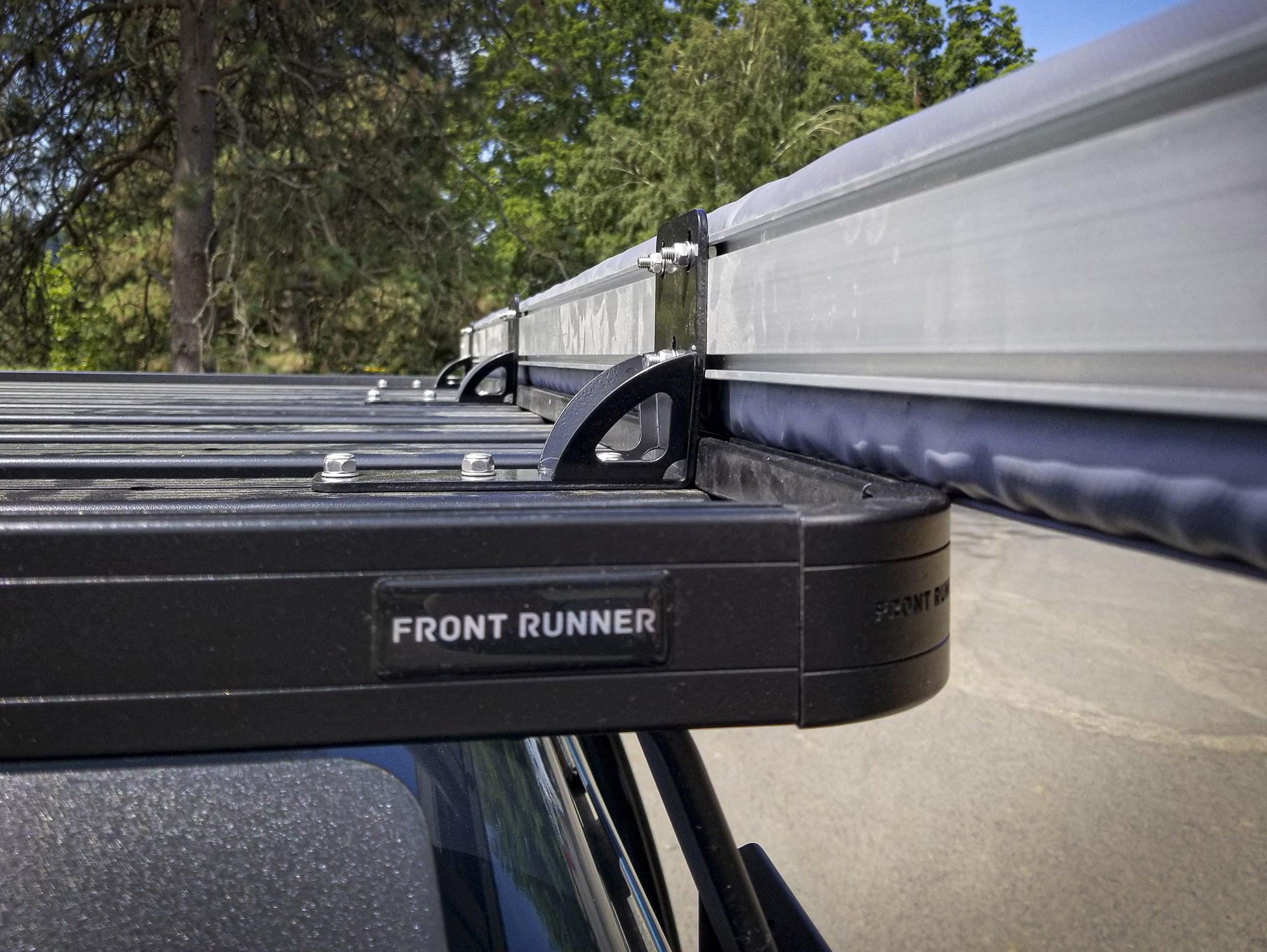 The black ARB Universal Awning Brackets fit perfectly on our black Front Runner Slimline II rack