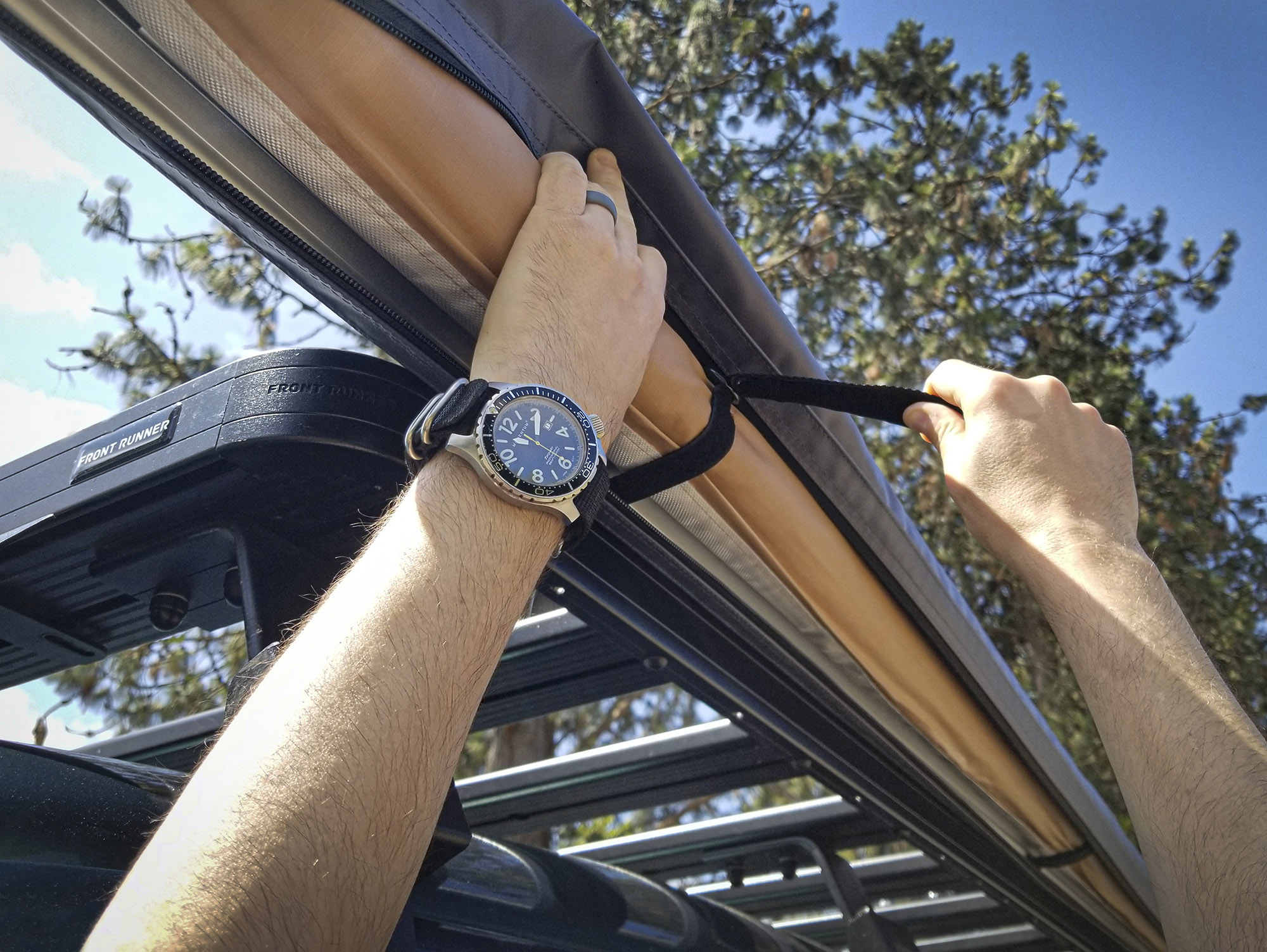 The ARB Touring Awning Kit with Light features a gray waterproof housing and interior Velcro to keep it in place when stowed.