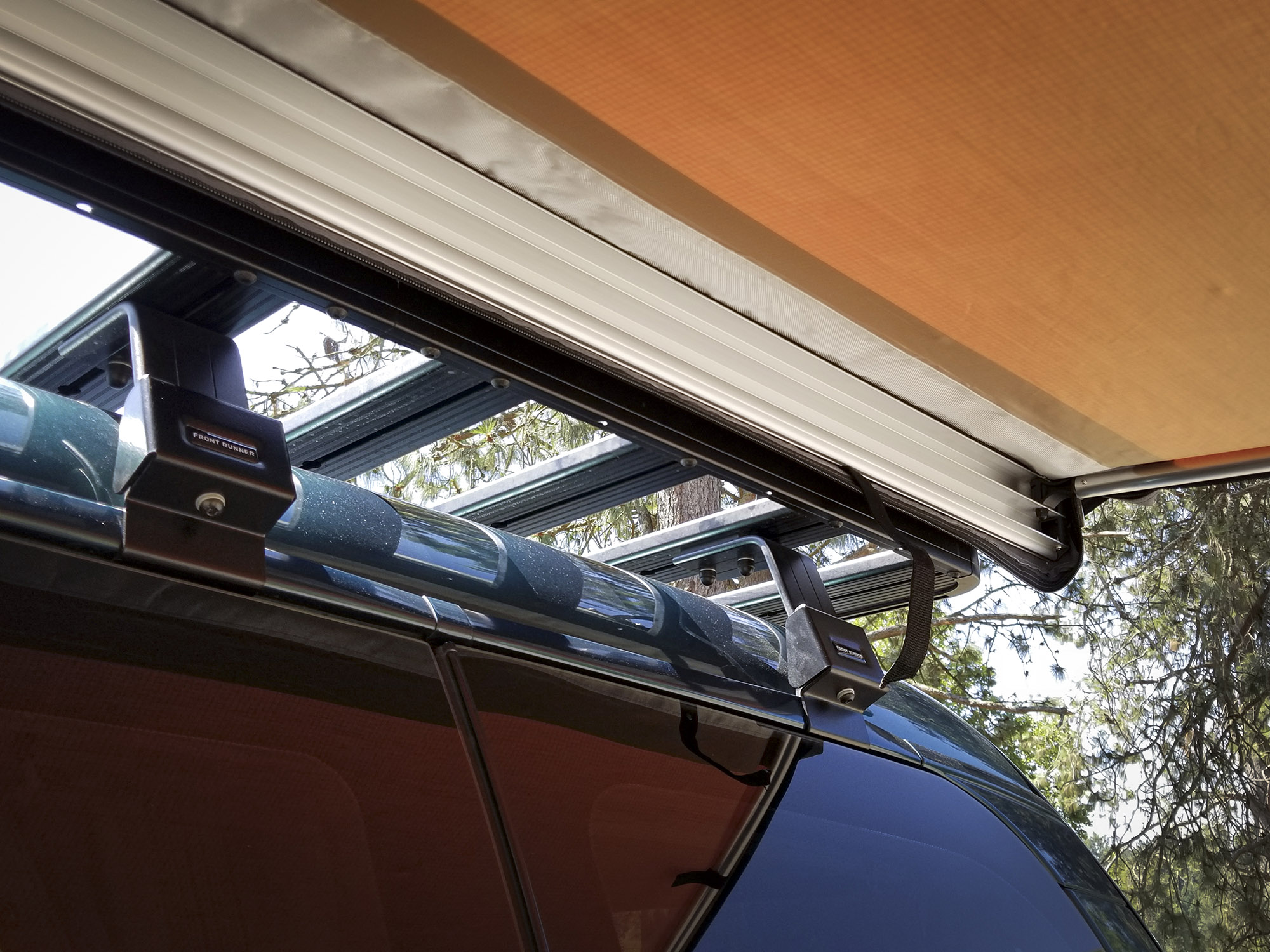 The awning housing features an aluminum chase for support poles and a waterproof zippered bag.