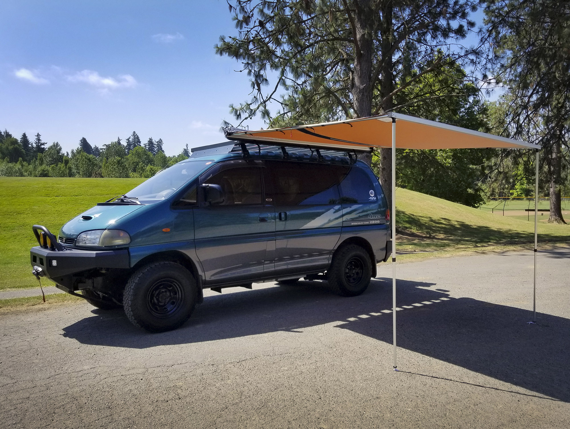 ARB814410 awning on teal Mitsubishi Delica Space Gear van