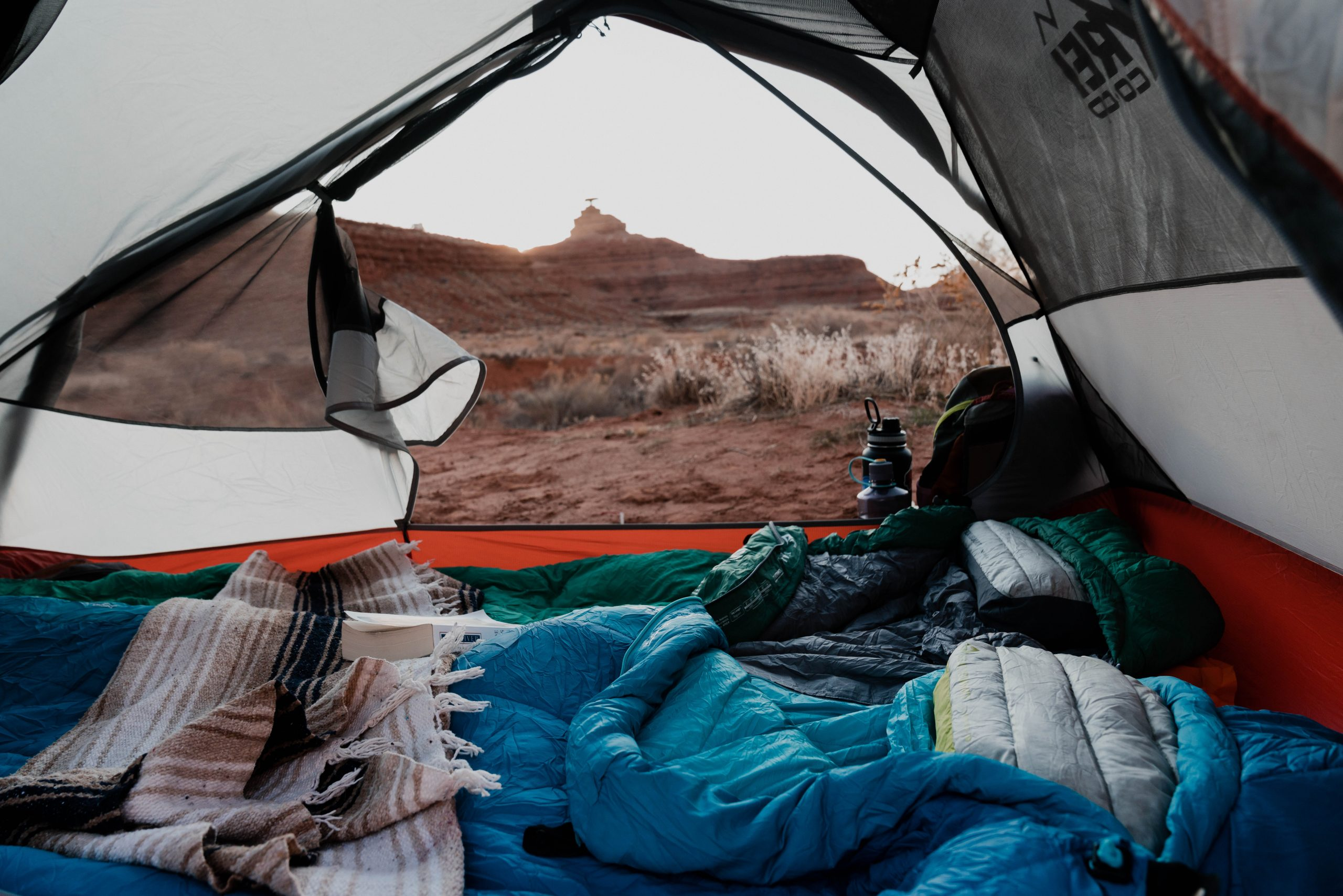 Sea to Summit inflatable pillows in tent with scenic desert background.