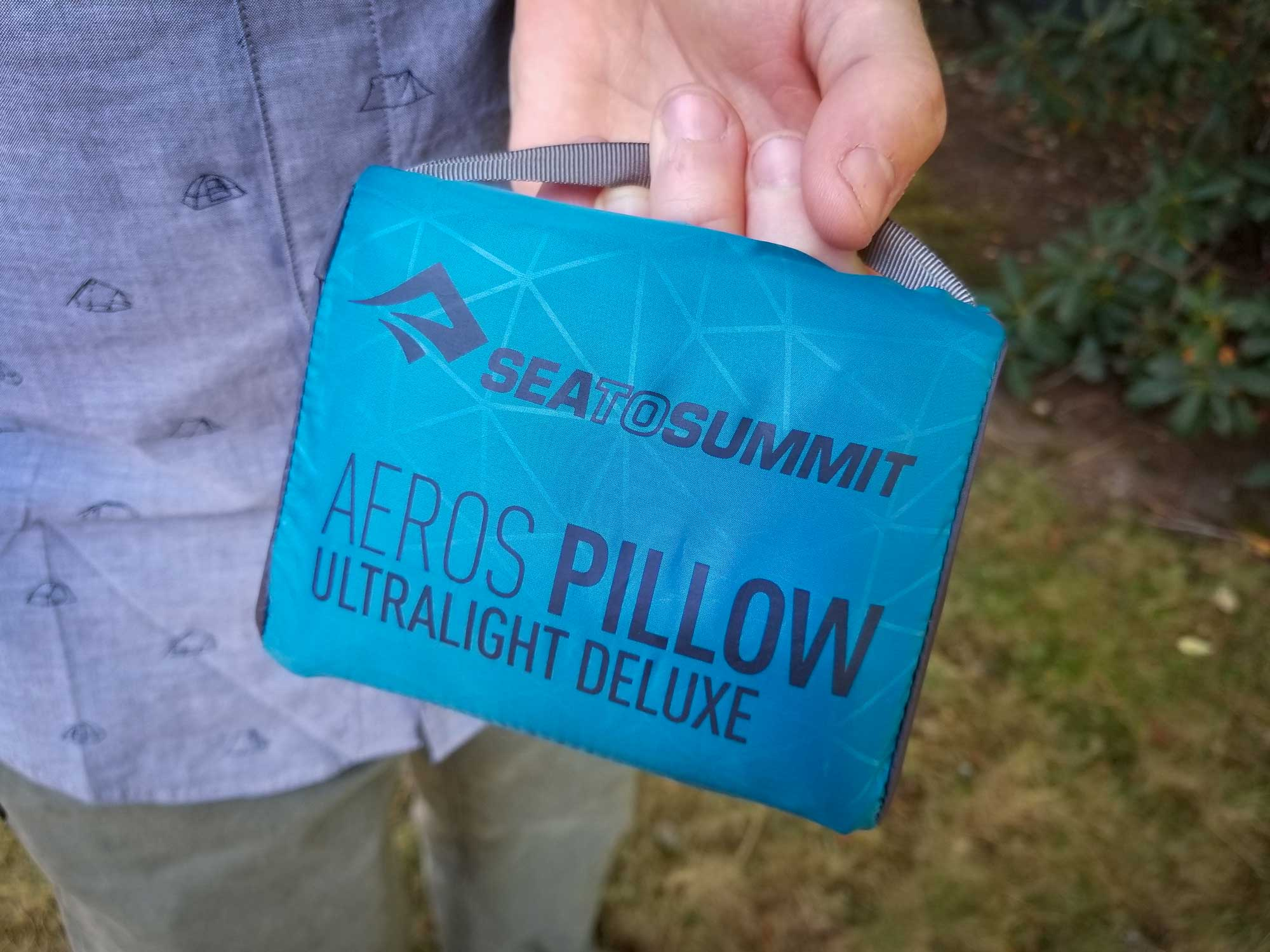 The Sea to Summit Aeros Ultralight Deluxe pillow comes in a blue zippered pouch.
